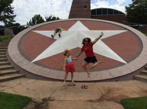 Emma Grace and I at the Texas state line, Alex collapsed on the star